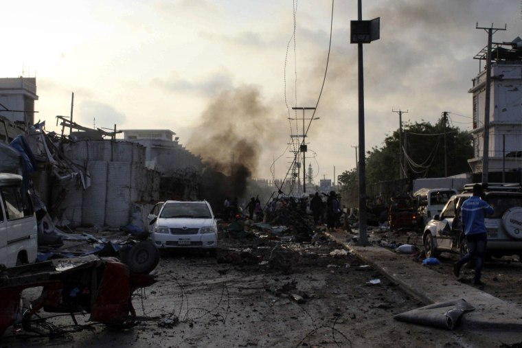 Image: Smoke rises in the aftermath of explosions outside a hotel in Somalia's capital Mogadishu