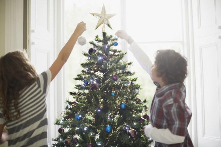 Image: Children decorating Christmas tree