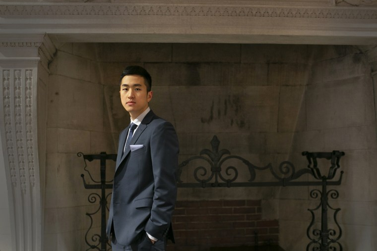 Jin Kyu Park, awarded a Rhodes Scholarship, stands in the Barker Center at Harvard University.