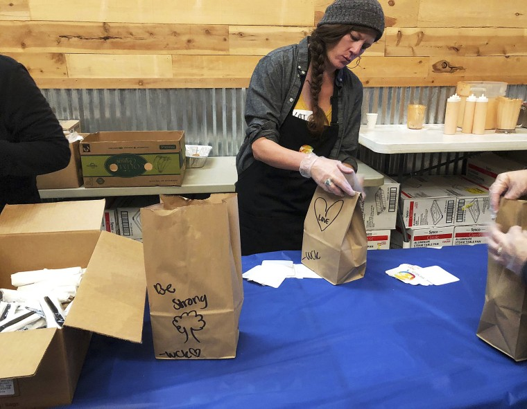 Image: Katherine Clement prepares bagged lunches for firefighters as she works with the nonprofit World Central Kitchen