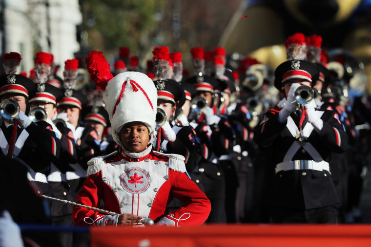 Image: A marching band performs during the Macy's Thanksgiving Day Parade in Manhattan
