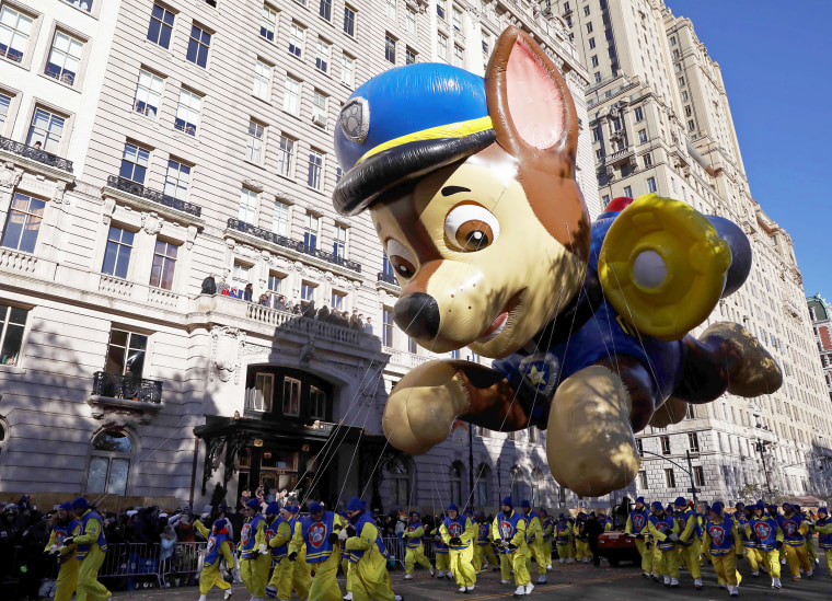 Image: A float hovers above the crowd during the Macy's Thanksgiving Day Parade in Manhattan