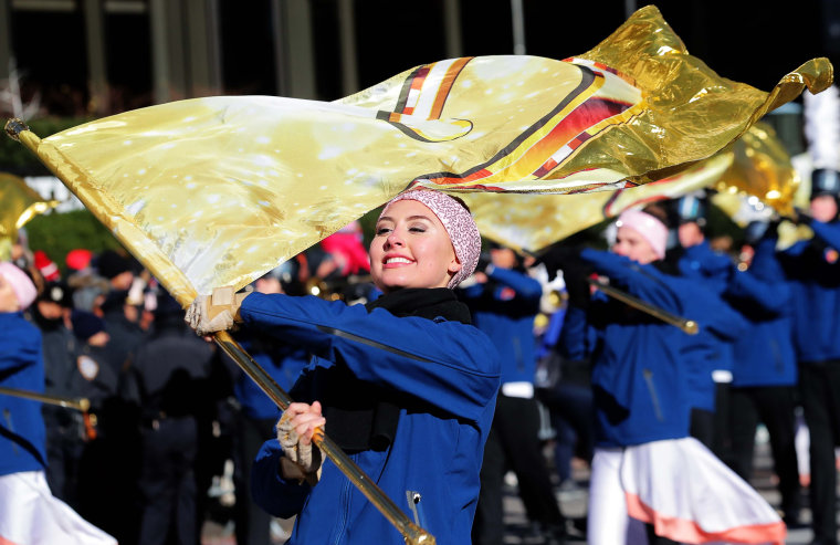Image: Participants perform during the Macy's Thanksgiving Day Parade in Manhattan