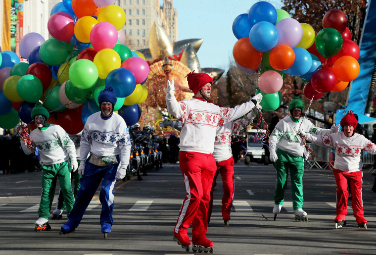 Image: Clowns on roller blades perform during the Macy's Thanksgiving Day Parade in Manhattan