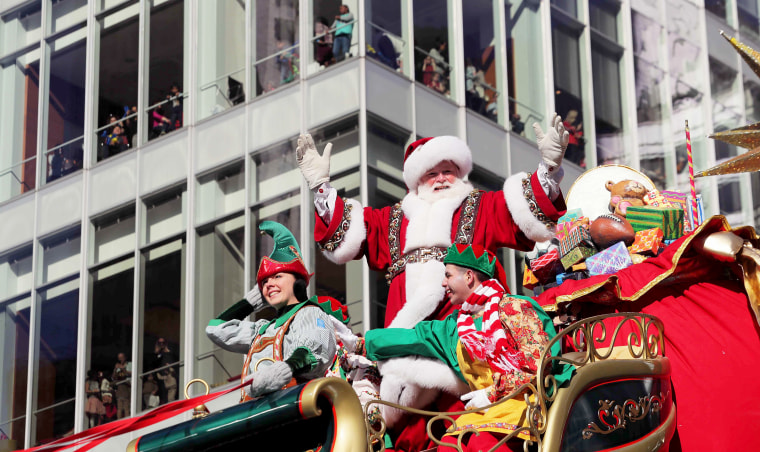 Image: Santa Claus waves to the crowd during the Macy's Thanksgiving Day Parade in Manhattan