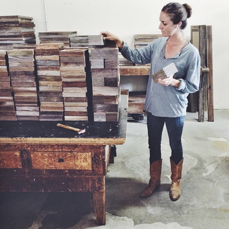 Paige Curtis organizes newly built frames and shadow boxes in the company workshop.
