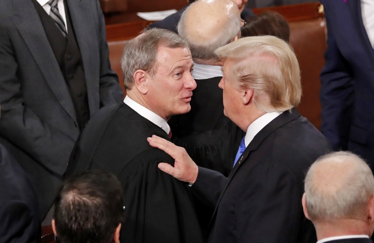 U.S. President Trump greets Justice Roberts after delivering his State of the Union address in Washington