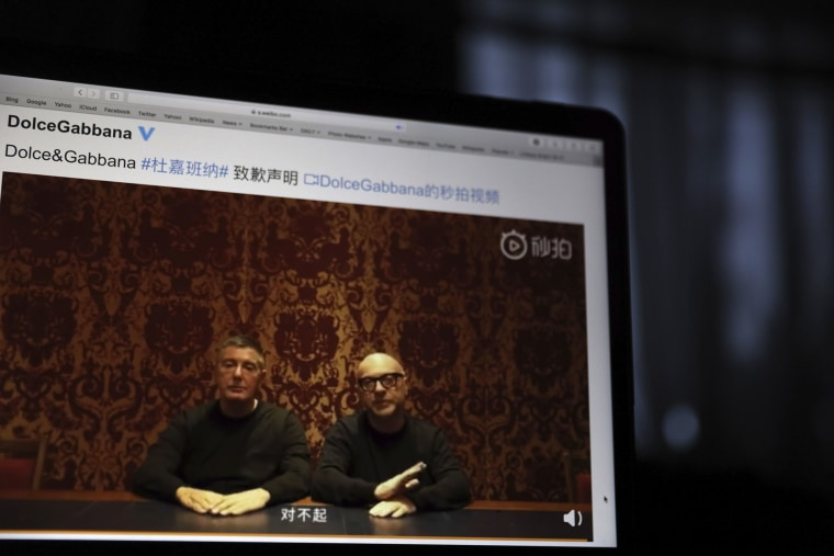 "Image: Founders of Dolce&Gabbana Domenico Dolce, left, and Stefano Gabbana apologize in a video on Chinese social media, saying ""sorry"" in Mandarin"