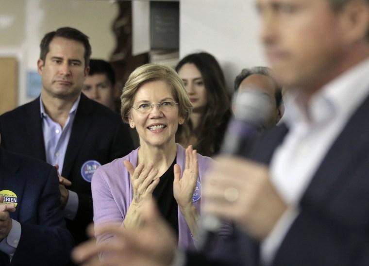 Image: Democrat U.S. Sen. Elizabeth Warren, center, applauds as Massachusetts gubernatorial candidate Jay Gonzalez addresses a crowd during a campaign stop