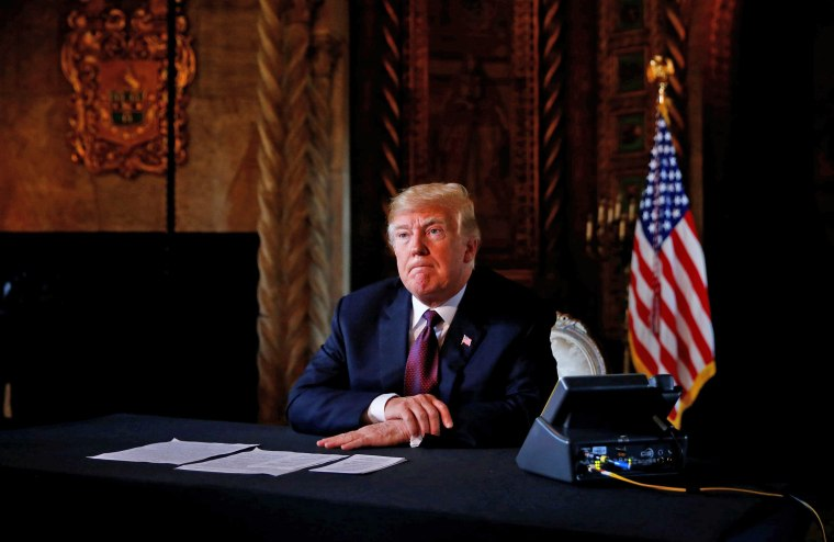 Image: U.S. President Donald Trump takes questions from the media after speaking via teleconference with troops from Mar-a-Lago estate in Palm Beach