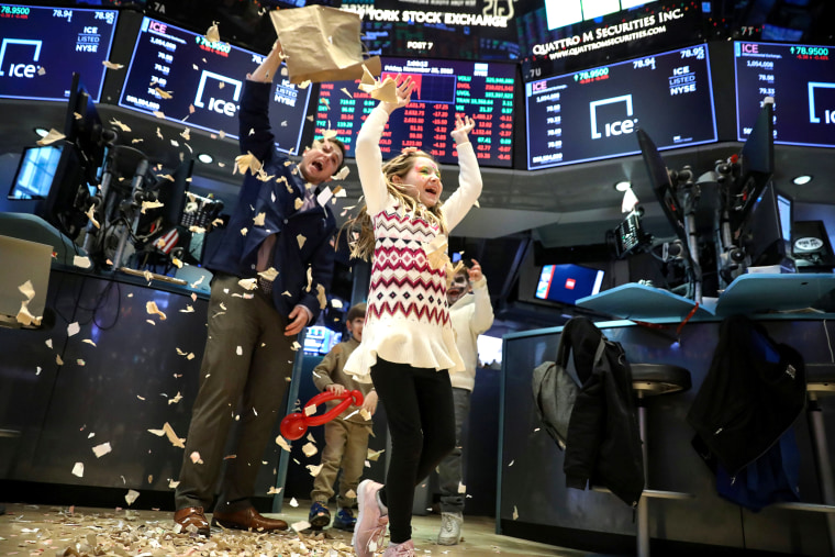 Image: Trader Ben Tuchman dumps paper during a traditional bring-your-kids-to-work day on the floor at the NYSE in New York