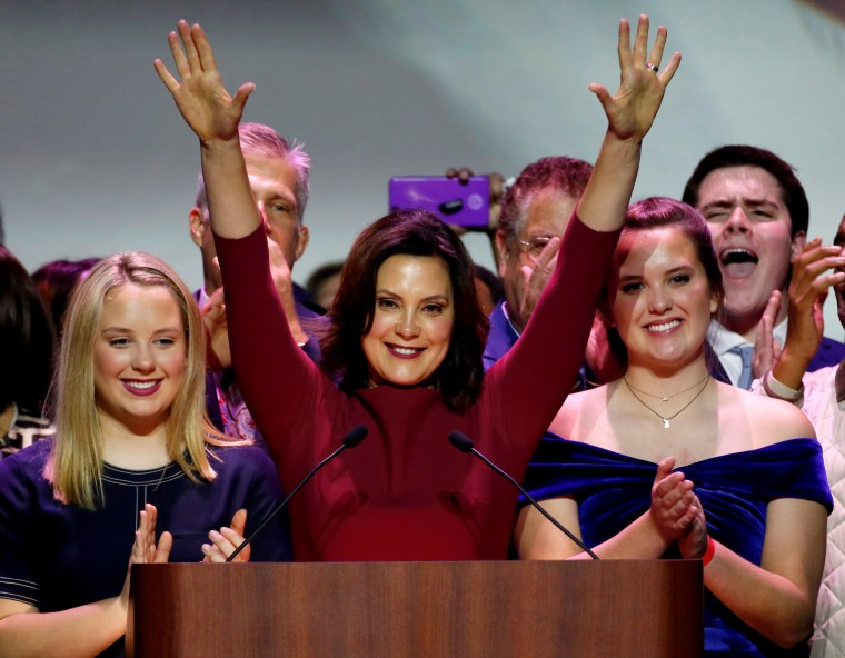 Image: FILE PHOTO: Democratic gubernatorial candidate Whitmer reacts with her daughters after declaring victory at her midterm election night party in Detroit,