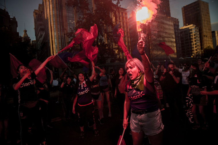 Activists take part in a march on the eve of the commemoration of the International Day for the Elimination of Violence Against Women,