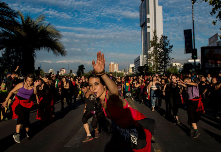 Image: Women take part in a march on the eve of the commemoration of the International Day for the Elimination of Violence Against Women
