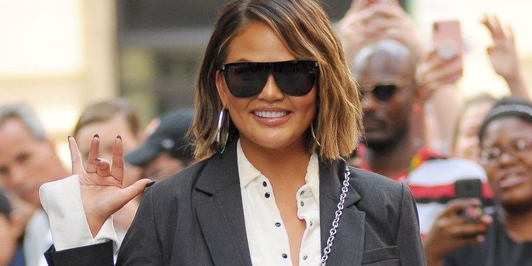 f89fac6db75 Chrissy Teigen wears a collared shirt on Sept. 19 in New York City
