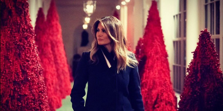 Melania with red Christmas trees