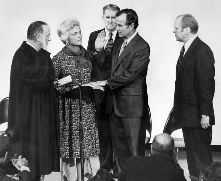 George Herbert Walker Bush (2nd R) is pictured wit