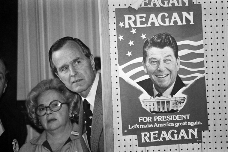 In the late '70s, Bush decided that he wanted to be president and began traveling the country in an attempt to drum up support. He entered the Republican primaries in early 1980 and had some early success before being defeated by Ronald Reagan. Here, he peeks around a partition displaying a poster of Reagan during an event in Columbia, S.C. At the convention later that year, Reagan selected Bush to be his running mate, placing him on the winning Republican presidential ticket.