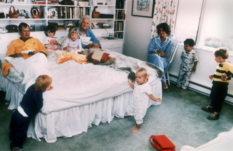 President and Barbara Bush have a bedroom get-together with grandchildren Pierce, twins Barbara and Jenna (in bed), Marshall, Jeb. Jr. and Sam during an August 1987 vacation at their summer home in Kennebunkport, Maine.