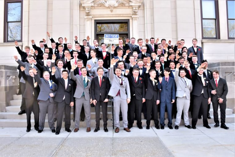 Image: Baraboo School District students appear to be make extremely inappropriate gestures during a class photo