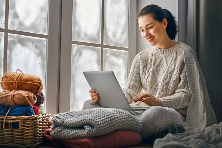 Image: woman sitting near windows