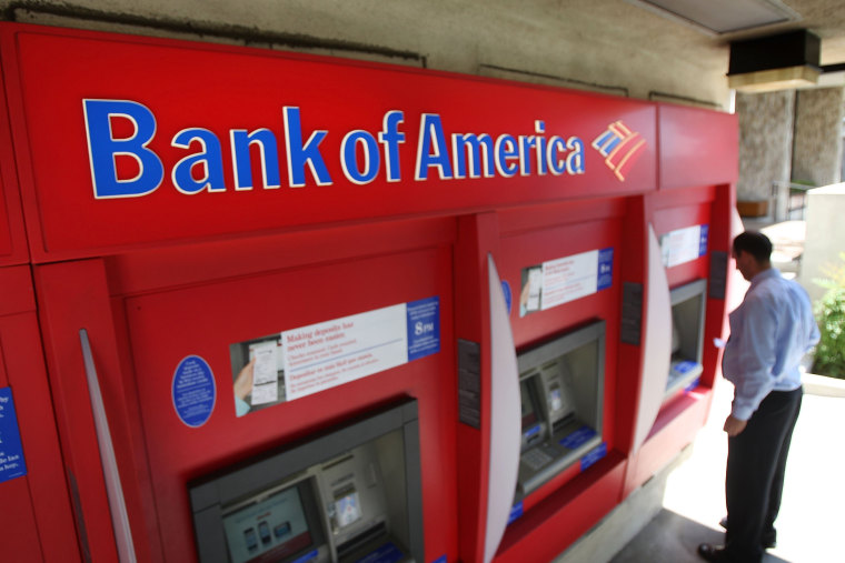 A man uses an ATM at a Bank of America branch in Pasadena, California, in 2009.
