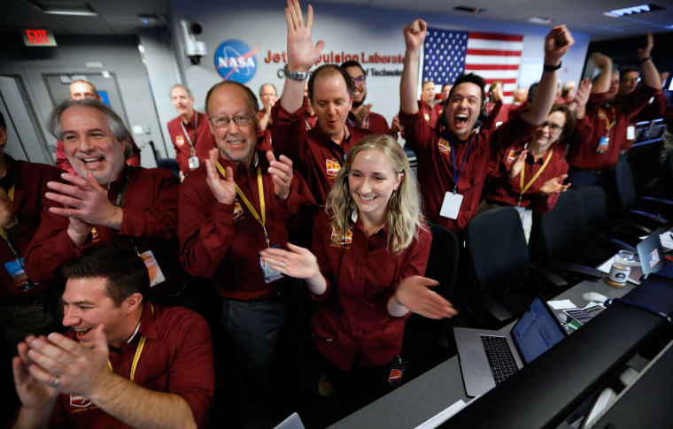 NASA flight team engineers celebrate the InSight spacecraft's successful landing on Mars at the NASA Jet Propulsion Laboratory in Pasadena, California, on Nov. 26, 2018.