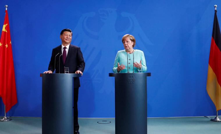 Image: Chinese President Xi Jinping and German Chancellor Angela Merkel