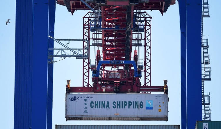 Image: A China Shipping container is loaded at a terminal in the port of Hamburg, Germany