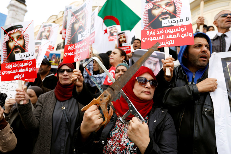 Image: Woman takes part in a protest, opposing the visit of Saudi Arabia's Crown Prince Mohammed bin Salman in Tunis