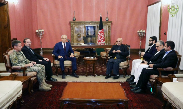 Afghanistan's President Ashraf Ghani, right, and U.S. special envoy for peace in Afghanistan, Zalmay Khalilzad, meet in Kabul