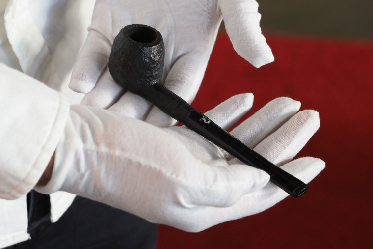 Image: A carved Briar pipe with custom Playboy Bunny logo is displayed as part of Julien's Auctions upcoming sale of late Playboy publisher Hugh Hefner's belongings