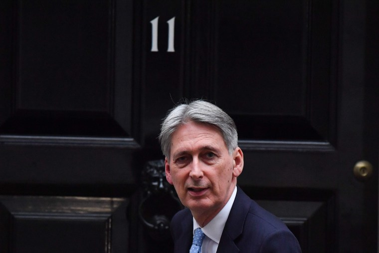 Image: Britain's Chancellor of the Exchequer Philip Hammond leaves 11 Downing Street in London