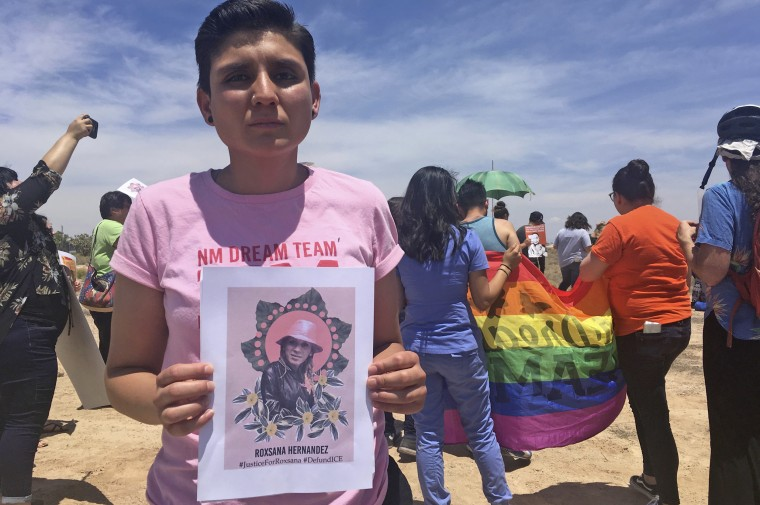 Gabriela Hernandez, executive director of the nonprofit New Mexico Dream Team, holds up an image of Roxsana Hernandez outside an ICE office in Albuquerque on June 6, 2018.