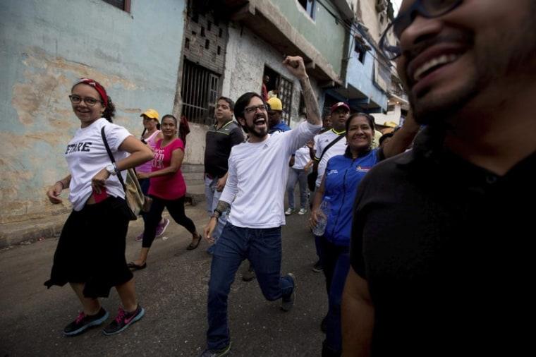 In Caracas, Venezuela, Democratic Unity opposition coalition congressman Miguel Pizarro greets supporters during a rally.