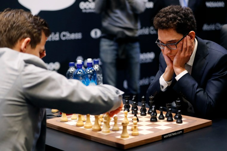 Fabiano Caruana, right, plays against Magnus Carlsen in the 2018 World Chess Championship in London on Nov. 28, 2018.