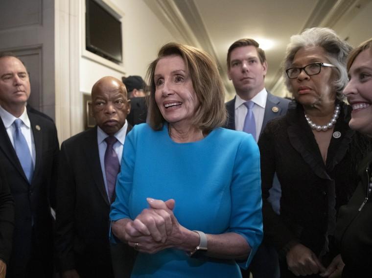 Image: Nancy Pelosi, John Lewis, Eric Swalwell