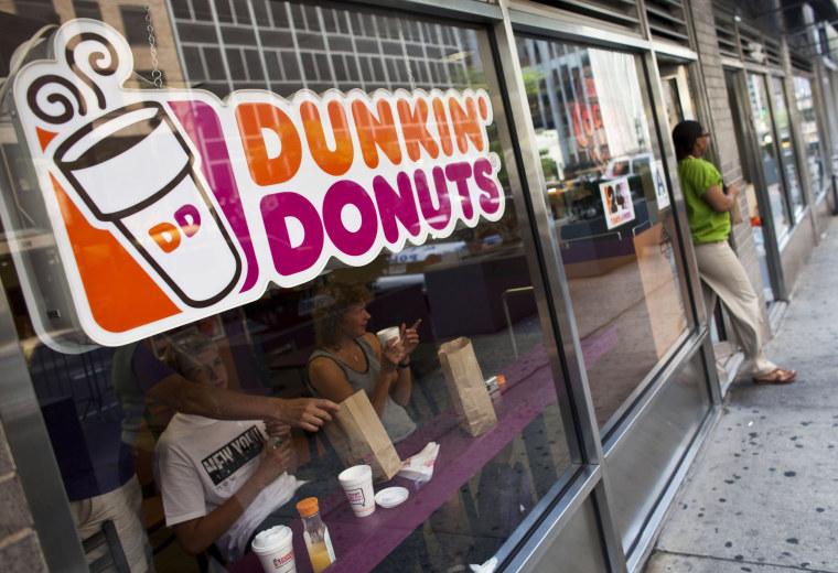 A customer exits a Dunkin' Donuts store in Manhattan in 2011.