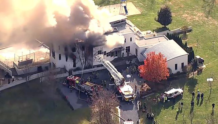 Firefighters at the scene of a fire in Colts Neck, New Jersey on Nov. 20, 2018