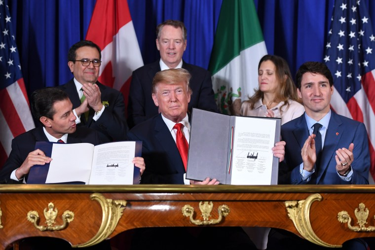 Mexico President Enrique Pena Nieto, left, President Donald Trump and Canadian Prime Minister Justin Trudeau sign a new free trade agreement at the G20 Leaders' Summit in Buenos Aires on Nov. 30, 2018.