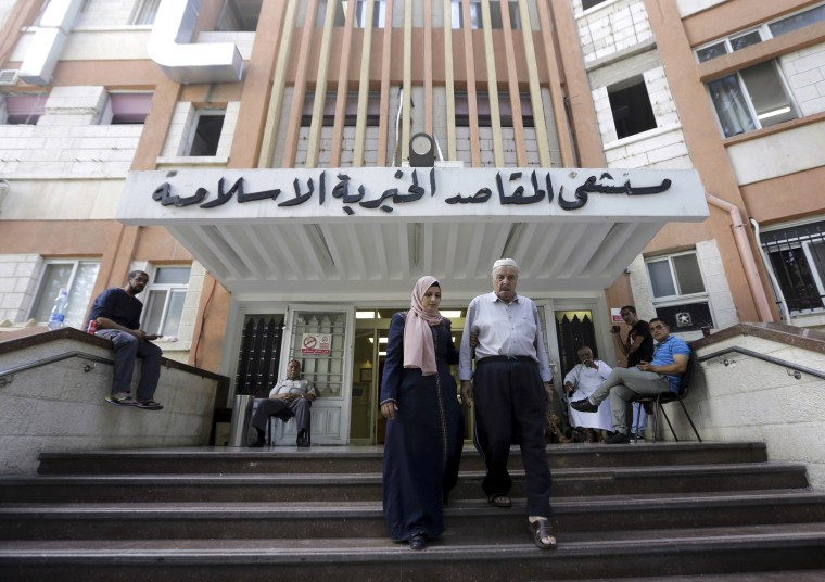 Palestinians leave the Makassed hospital in East Jerusalem on Sept. 9, 2018.