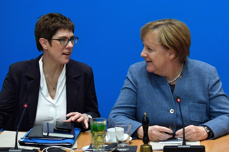 Image: German Chancellor and leader of the Christian Democratic Union Angela Merkel and Annegret Kramp-Karrenbauer talk during a party leadership meeting in Berlin