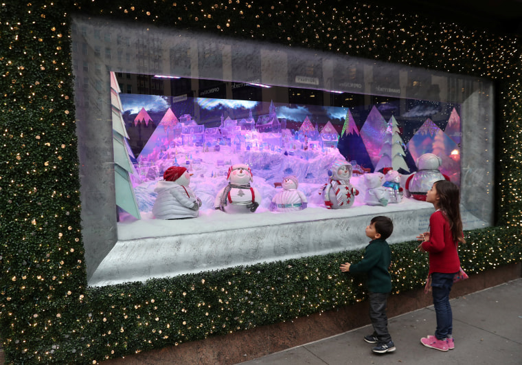 Children look at the Christmas holiday window displays at Macy's Herald Square in Manhattan, U.S., December 3, 2018.