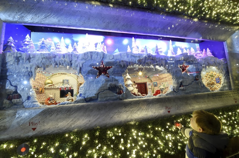 """Macy's Herald Square unveils its legendary Christmas windows celebrating the theme \""""Believe In The Wonder Of Giving,\"""" Thursday, Nov. 15, 2018, in New York. The six enchanted windows share a tale of friendship, family, adventure, and teamwork as Sunny the Snowpal works to save Christmas with the help of her friends."""