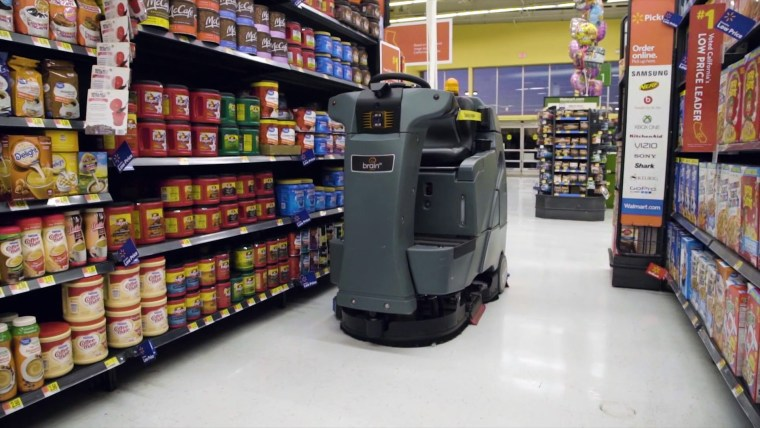 Walmart's BrainOS-powered floor scrubbers are equipped with sensors to clean around customers.