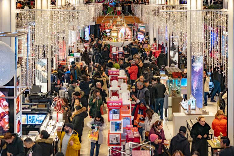 People shop at Macy's for the early Black Friday sales in New York on Nov. 22, 2018.