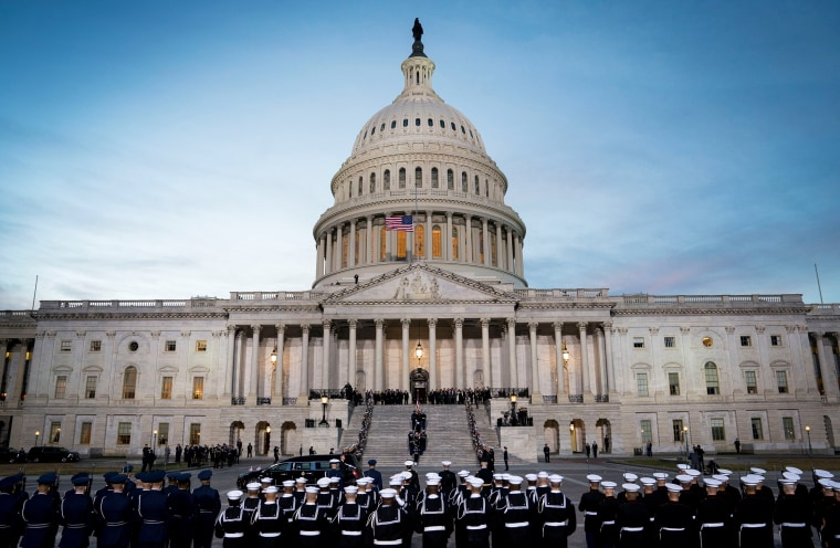 Image: The casket carrying former president George Herbert Walker Bush is carried up the steps of the US Capitol in Washington