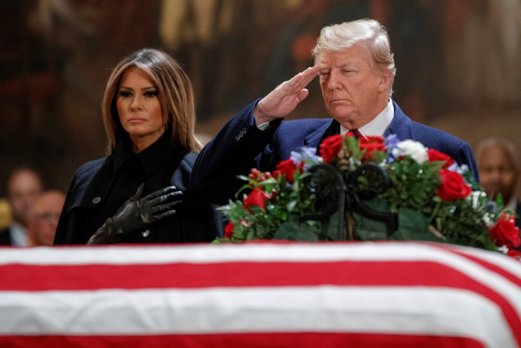 Image: US President Donald J. Trump, with First Lady Melania Trump, salutes the casket containing the body of former US President George H.W. Bush in the Rotunda of the US Capitol in Washington