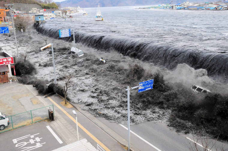 Waves approach Miyako City after a 9.0 magnitude earthquake hit Japan and triggered a tsunami on March 11, 2011.