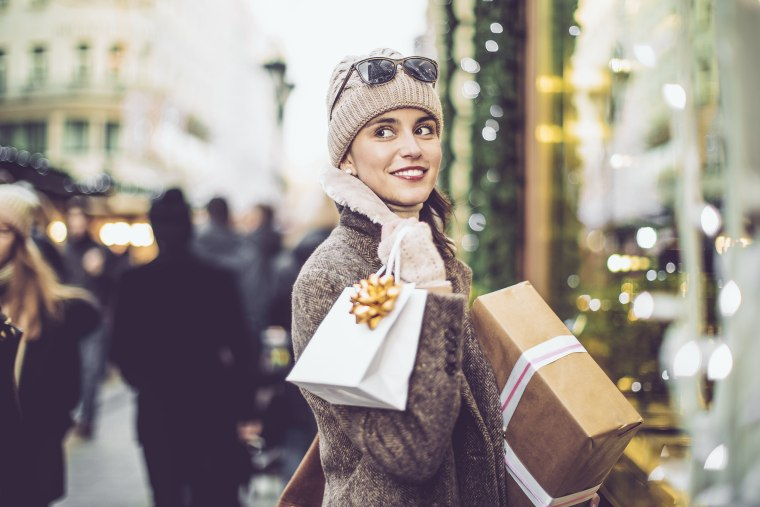 A woman carries her purchases